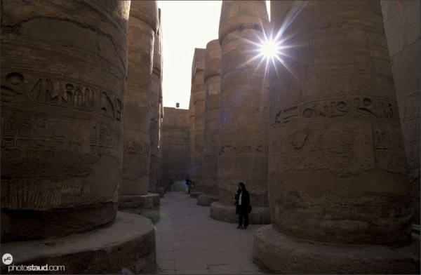 Sun penetrates through the huge stone columns of the Great Hypostyle Hall in the Temple of Amun at Karnak, Luxor - Thebes, Egypt