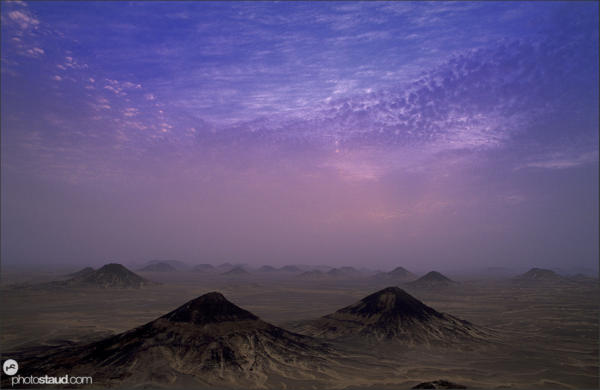 Twilight in the volcanic landscape of the Black Desert, Egypt
