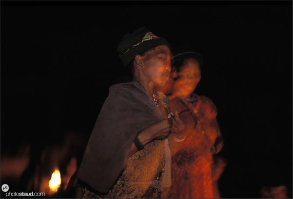 Bushman of Den/ui village performing night fire dances, Namibia