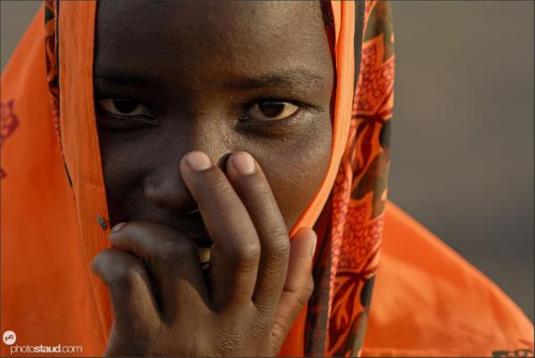 El Molo woman in a bright orange blanket, Northern Kenya
