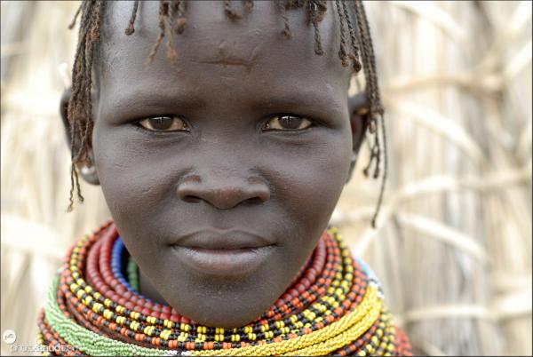 Turkana girl living with El Molo people at Lake Turkana, Northern Kenya