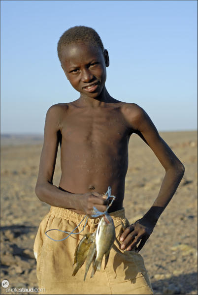Boy and fish, El Molo people at Lake Turkana, Northern Kenya