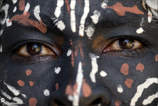 Close up portrait of dark-painted Kikuyu tribesman, Kenya