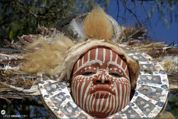 Portrait of Kikuyu tribeswoman with painted face and headdress made of ostrich feathers, Kenya