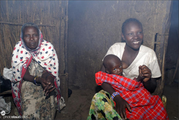 Maasai woman breastfeeding her child  life inside Maasai village, Kenya