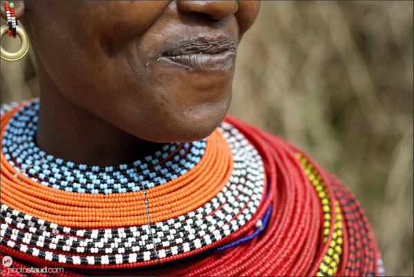 Smiling lips of Samburu woman with colorful bead necklaces, Kenya