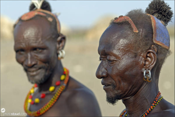 Turkana medicine men wearing clay hairdo and genuine tribal ornaments, Kula Samaki, Northern Kenya