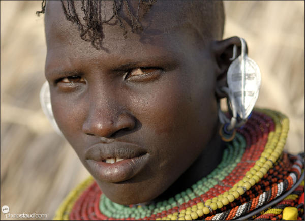 Close up portrait of Turkana girl with traditional hairstyle and bead decorations, Loyangalani, Northern Kenya