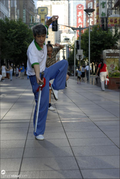 Chinese people practicing martial arts on the Nanjing-lu road, Shanghai, China