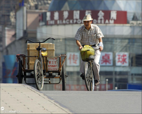 Riding bicycle, Shanghai, China