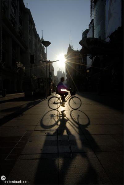 Early morning cyclist in Shanghai, Shanghai, China