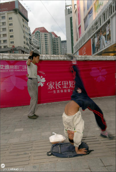 Chinese boys showing their kung-fu skills on Kunming streets, Yunnan, China