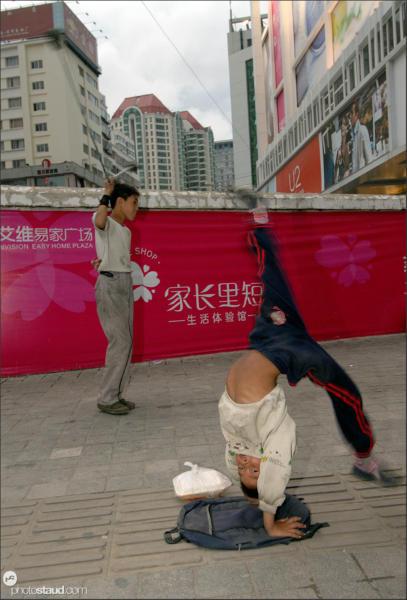 Chinese boys showing their kung-fu skills on Kunming streets, Yunnan, China