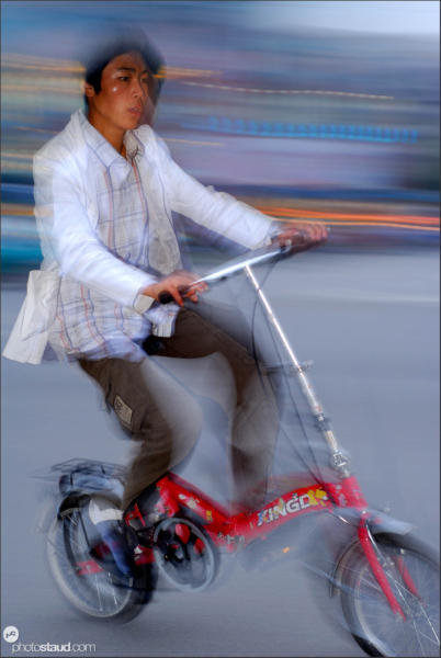 Chinese man riding bicycle, China