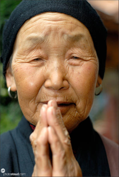 Elderly Chinese woman praying, China