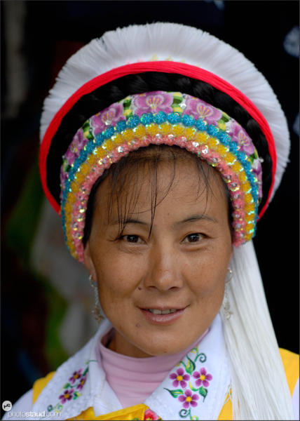 Chinese woman wearing traditional Naxi dress, Shuhe village, Yunnan, China