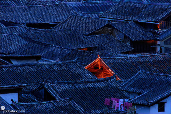 Famous roofs of Lijiang town at night, Yunnan, China