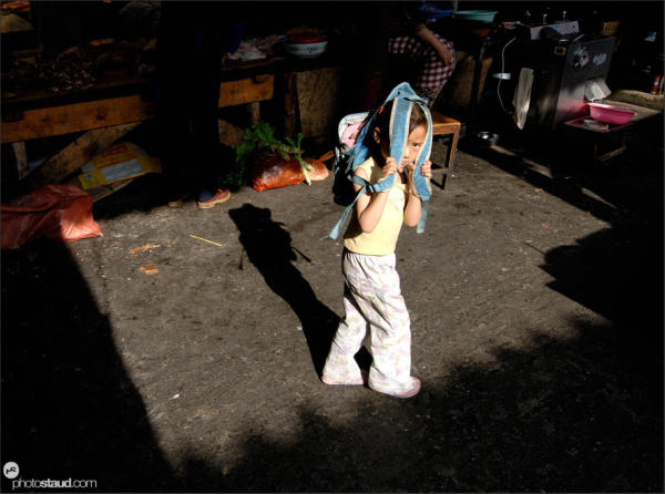Little Chinese girl on the way to school, Lijiang, Yunnan, China