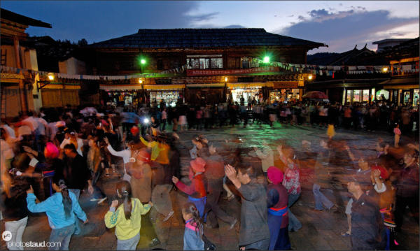 People dancing in the streets of Zhongdian – Shangri-la, Yunnan, China