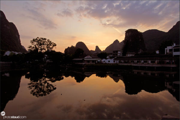 Karst peaks mirroring in the Li river, Yangshuo, Guangxi, China