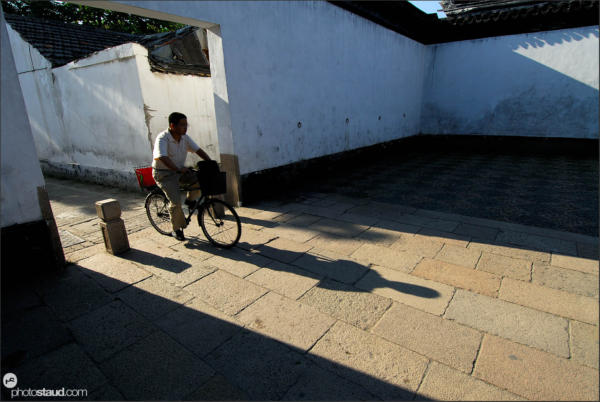 Chasing shadows - Chinese man on bicycle, Suzhou, Jiangsu Province, China