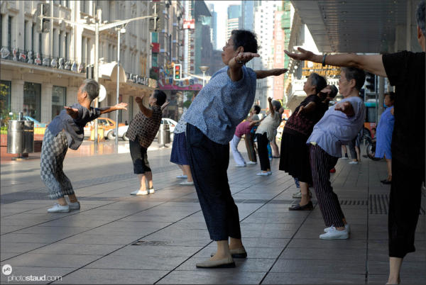 Elderly Chinese women doing morning exercise in the streets of Shanghai, China