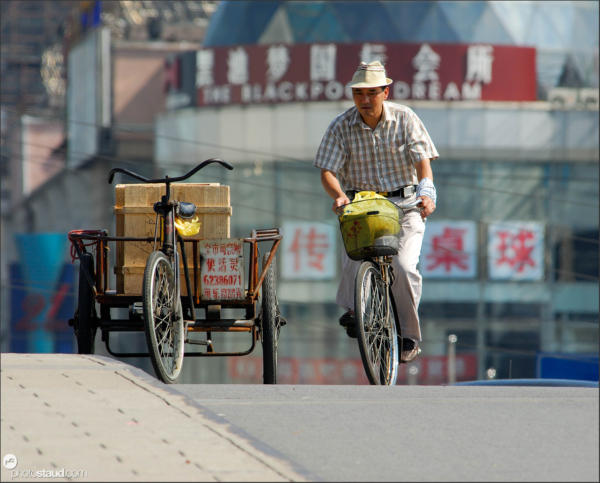 Riding bicycle, Shanghai, China