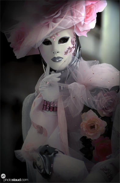 Beauty in pink Woman dressed in ornamental carnival costume, Venice, Italy
