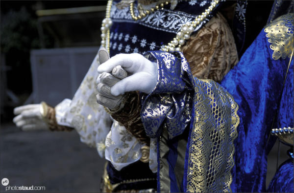 Hand in hand - street performers of Venice Carnival, Italy